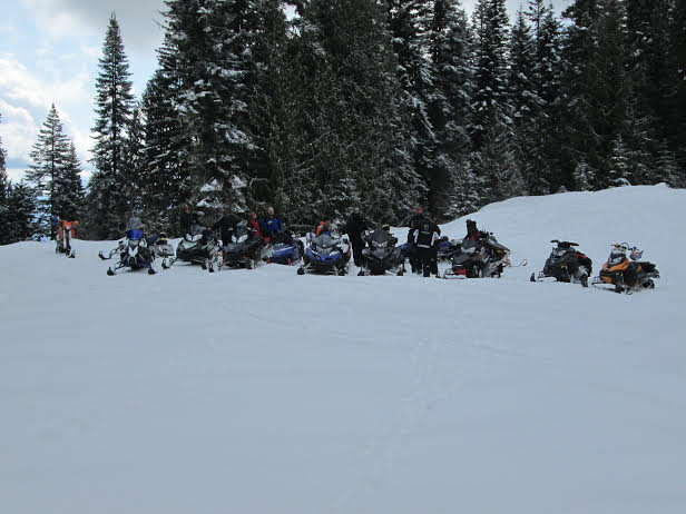 There is safety in numbers, and it's more fun too. A pause in the festivities during the 2014 SnoDrifters club ride. Latah SnoDrifters photo.