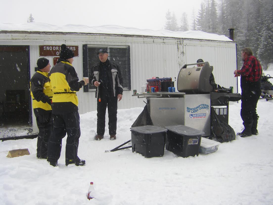 Riders share good food with good friends after a sponsored run in 2014. Latah Snowdrifters photo.