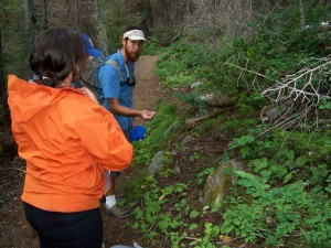 During the hike, Jung acts as a nature guide, pointing out various plants such as heart-shaped arnica, Oregon grape and wild huckleberries. (Mike McClaskey photo)