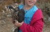 Youngsters get a hands-on hawk experience during the Boise State University public field trip to Lucky Peak. (IBO photo)