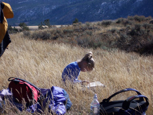 Student writing in journal during Epedition Yellowstone!; Photographer unknown; October 2005