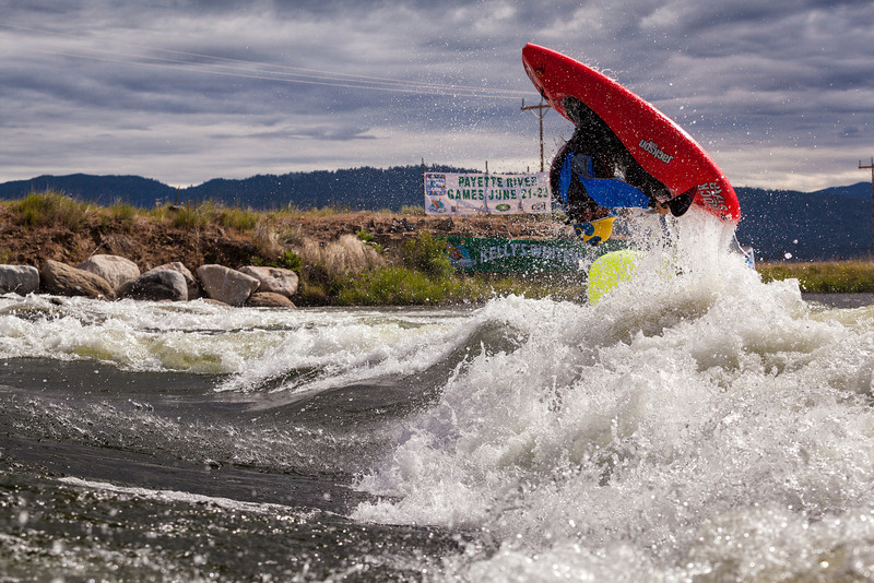 Stephen Wright with a huge Air-Loop at Kelly's Whitewater Park during the 2013 Payette River Games in Cascade Idaho