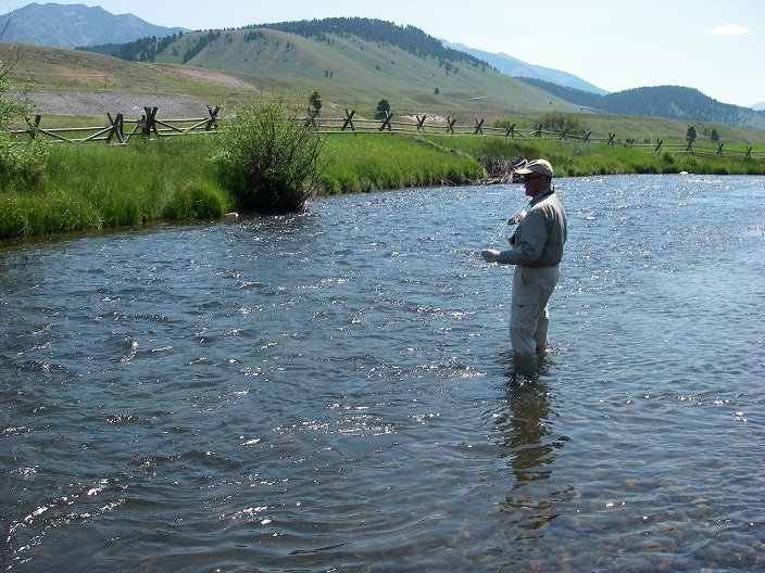 Keith Carlson casts a dry fly within view of one of the Madison River's famous fence lines. (Brad Carlson photo)