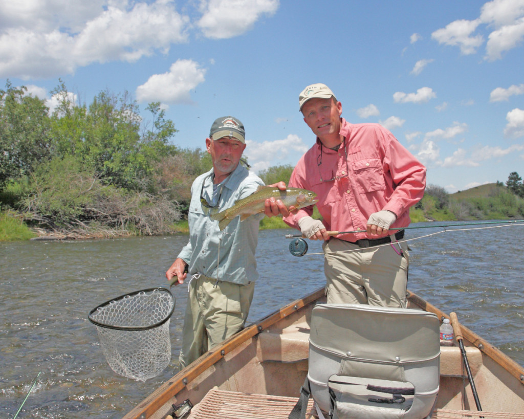 Madison River Outfitters guide Rick Welle and the author with one of the Madison's sizable rainbow trout. (Keith Carlson photo)