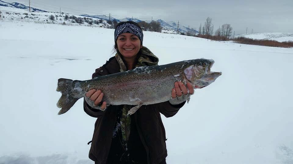 Lindsey Enright of Salt Lake City won the 2016 Big Dog Ice Fishing Tournament at Devils Creek Reservoir with a 27-inch rainbow trout. (Big Dog Fishing Club photo)